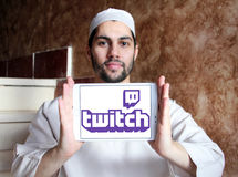 Twitch mobile logo. Logo of Twitch on samsung tablet holded by arab muslim man. twitch is a live streaming video platform for gamers owned by amazon Stock Image