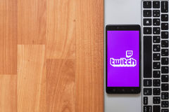 Twitch on smartphone screen. Los Angeles, USA, july 18, 2017: Twitch on smartphone screen placed on the laptop on wooden background Royalty Free Stock Photos