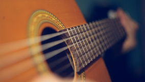 Twitching string guitar. Video macroshot of the game on an acoustic guitar stock video footage