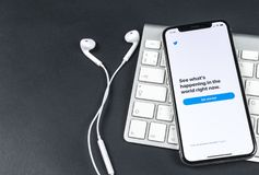 Twitter application icon on Apple iPhone X smartphone screen close-up. Twitter app icon. Social media icon. Social network. Sankt-Petersburg, Russia, April 6 Stock Photography