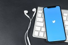 Twitter application icon on Apple iPhone X smartphone screen close-up. Twitter app icon. Social media icon. Social network. Sankt-Petersburg, Russia, April 6 Stock Images
