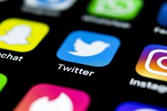 Twitter application icon on Apple iPhone X smartphone screen close-up. Twitter app icon. Social media icon. Social network. Sankt-Petersburg, Russia, April 12 Stock Photos