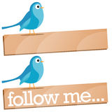 Twitter Bird with Follow Me sign. Two Twitter Follow Me sign with a blue birds Royalty Free Stock Photography