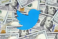 Twitter bird icon printed on paper, cut and placed on money background stock images