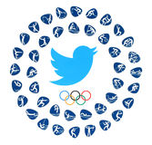 Twitter bird logo with Olympic Games Rings and kinds of sport. Kiev, Ukraine - August 03, 2016: Twitter bird logo with Olympic Games Rings and kinds of sport of royalty free stock images
