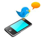 Twitter bird standing on a smartphone. Vector illustration representing a cute blue bird standing on a cell phone Royalty Free Stock Image