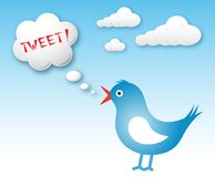 Twitter bird and text cloud with tweet. Blue twitter bird and text cloud with tweet against blue sky Stock Photography