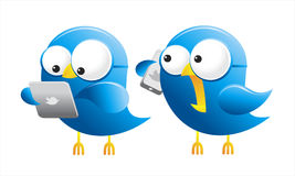 Twitter Birds. Isolated twitter birds with gadgets Royalty Free Stock Photo