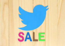 Twitter icon printed on paper with color label Sale Royalty Free Stock Photos