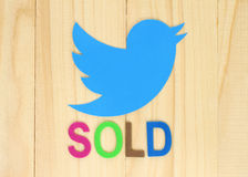 Twitter icon printed on paper with color label Sold. Kiev, Ukraine - September 29, 2016: Twitter icon printed on paper with color label Sold on wooden background Royalty Free Stock Photography