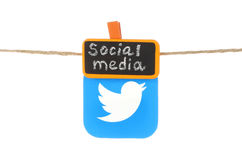 Twitter icon printed on paper, hangind on a rope Stock Images