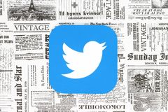 Twitter icon on retro newspaper background. Kiev, Ukraine - February 08, 2018: Twitter icon printed on paper and placed on retro newspaper background Stock Photos