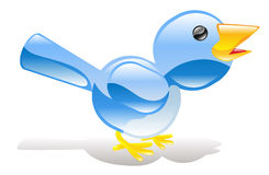 Twitter ing blue bird icon Stock Photo