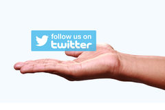 Twitter. Johor, Malaysia - Jun 24, 2014: Hand showing follow us on Twitter icon, Twitter is a popular free social networking website in the world, Jun 24, 2014 royalty free stock photos