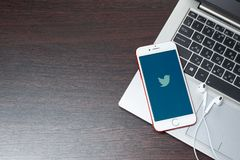 Twitter logo on iphone screen placed on laptop keyboard. Tula, Russia, March 12, 2019: Twitter logo on iphone screen placed on laptop keyboard.- Image stock photography