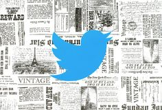 Twitter logo placed on retro newspaper background. Kiev, Ukraine - January 15, 2018: Twitter logo printed on paper and placed on retro newspaper background Royalty Free Stock Photos