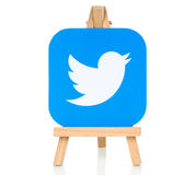 Twitter logo placed on wooden easel. Kiev, Ukraine - August 30, 2016: Twitter logo printed on paper and placed on wooden easel. Twitter is a well-known social royalty free stock photography