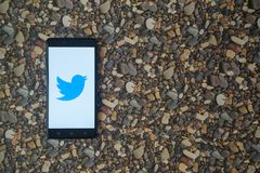 Twitter logo on smartphone on background of small stones. Los Angeles, USA, october 18, 2017: Twitter logo on smartphone on background of small stones royalty free stock photos