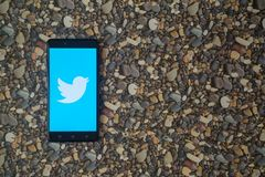 Twitter logo on smartphone on background of small stones. Los Angeles, USA, october 18, 2017: Twitter logo on smartphone on background of small stones Stock Images