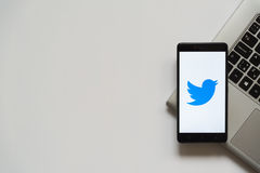 Twitter logo on smartphone screen. Bratislava, Slovakia, April 28, 2017: Twitter logo on smartphone screen placed on laptop keyboard. Empty place to write stock photos