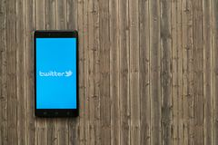Twitter logo on smartphone screen on wooden background. Los Angeles, USA, november 7, 2017: Twitter logo on smartphone screen on wooden background Stock Photo