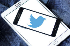 Twitter logo. Twitter social networking logo and vector on samsung mobile phone a5 on samsung tablet tab s2 stock photo