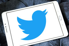 Twitter logo. Twitter social networking logo and vector on samsung tablet royalty free stock photo