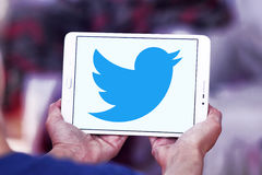 Twitter logo. Twitter social networking logo and vector on samsung tablet in hands stock photos