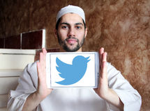 Twitter logo. Twitter social networking logo and vector on samsung tablet holded by arab muslim man royalty free stock photography