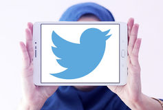 Twitter logo. Twitter social networking logo and vector on samsung tablet holded by arab muslim woman stock photo