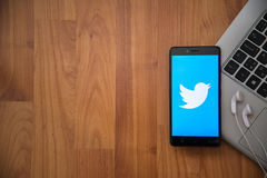 Twitter. Los Angeles, USA, april 16, 2017: Twitter application on smartphone with earphones and notebook on wooden background stock photo