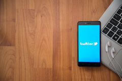 Twitter. Los Angeles, USA, april 16, 2017: Twitter application on smartphone with earphones and notebook on wooden background stock photography
