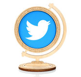Twitter paper logo placed in wooden globe. Kiev, Ukraine - March 03, 2017: Twitter paper logo placed in wooden globe on white background. Twitter is an online royalty free illustration