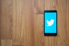 Twitter on smartphone. Los Angeles, USA, july 13, 2017: Twitter logo on smartphone screen on wooden background royalty free stock photo