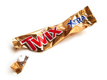 Twix Xtra chocolate bar empty crumpled wrapper isolated on white. Khabarovsk, Russia - April 10, 2017: Food packaging garbage Royalty Free Stock Image