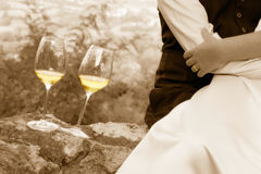 Two. Toned image slightly blurred. Two glasses of champagne near newlyweds tenderly embraced each other Royalty Free Stock Image