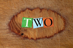 Two. Text on a wooden board Royalty Free Stock Images
