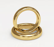 Two 3d gold wedding rings Stock Images