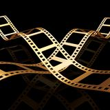Two 3d golden film strip. With light effect Royalty Free Stock Photo