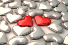 Two 3d red hearts on white hearts background Stock Photos