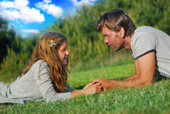 We two. Father and his daughter relaxing on a meadow Stock Images