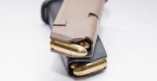 Free Two 9mm Pistol Magazines Loaded With Full Metal Jacket Bullets Royalty Free Stock Photography - 149179167