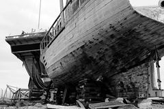 Two abandoned boats. View of two abandoned and broken old boats on a shipyard Stock Photography