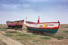 Two abandoned boats on a beach royalty free stock photo