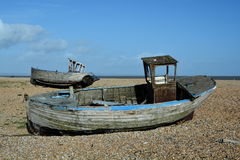 Two abandoned boats. Two abandoned fished boats on a deserted beach Royalty Free Stock Image