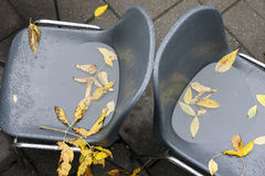 Two abandoned cafe chairs at fall Stock Photography