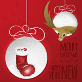 Two abstract Christmas balls with deer and santas boot cutted from paper. Abstract Christmas balls cutted from paper on red background with santas boot, balls Royalty Free Illustration