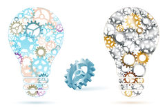 Two abstract lightbulbs from gears. Two abstract lightbulbs from multicolored gears and blue metal 3D gear with shadows -  on white background. Vector Stock Photo