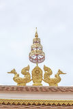 Two abstract sculpture golden swan on the roof in public temple Royalty Free Stock Images