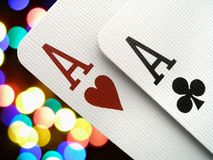 Two aces. Over colorful background royalty free stock photos